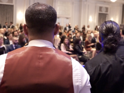 2 person standing infront of audience